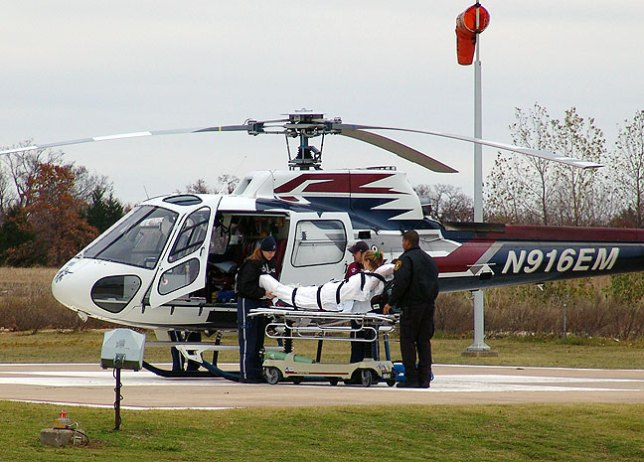 Medical technicians load Abby onto a helicopter this afternoon; as I was writing this (hurriedly as I prepared to drive to Oklahoma City), one of the med techs called to say she was at the Heart Hospital, safe and sound.