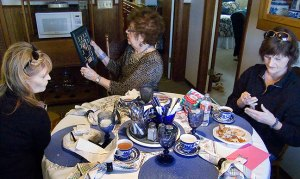 Abby, Ethel and Abby's sister Gail exchanged Christmas gifts after lunch.