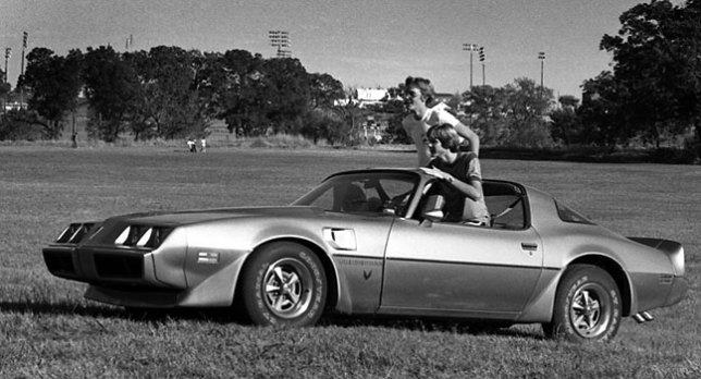 This is Jeff's Trans Am, with Jeff and our friend Allen sitting up through the open t-top roof, in 1980.