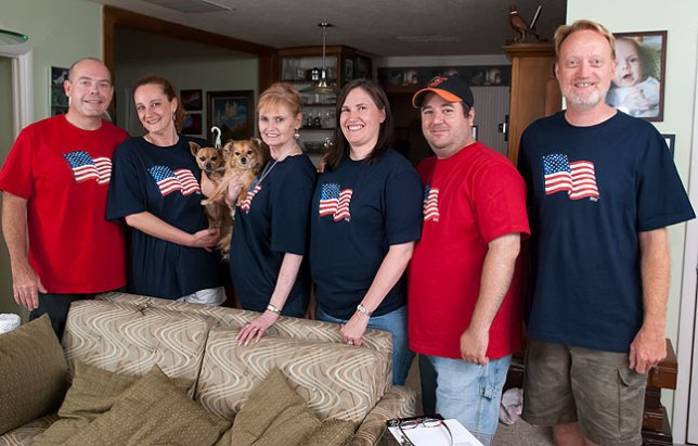 I found U. S. Flag t-shirts for everyone on sale on July 5. Posing from left to right are newlyweds Tracey and my sister Nicole, Chihuahuas Max and Sierra, my wife Abby, Chele, Tom, and me. Paul was already asleep, but you can see his image in this picture behind me.