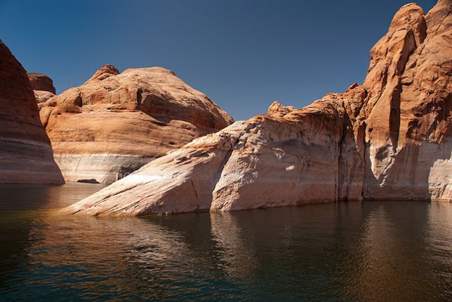Stark, angular, colorful, and beautiful, this image made in Forbidden Canyon, an arm of Lake Powell, is similar to some of the scenes in the early minutes of Planet of the Apes.