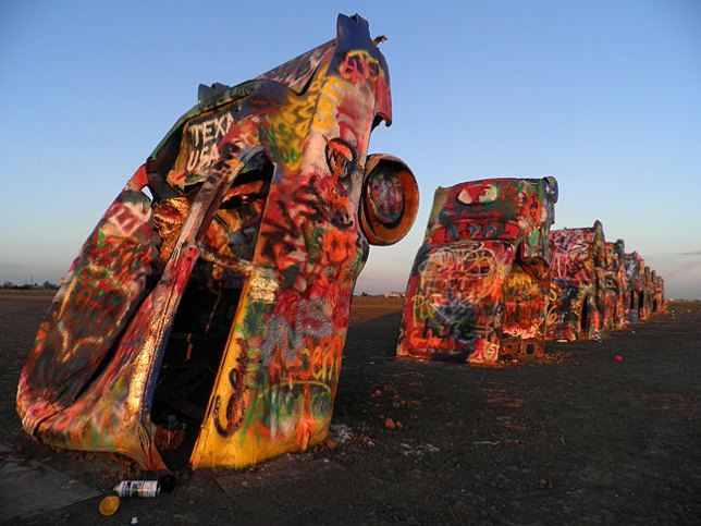 Stanley Marsh's Cadillac Ranch on the west end of Amarillo, Texas, is completely non-commercial, set in the middle of a wheat field with nothing else around. This image was made at sunset in November 2012.