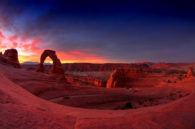 This high dynamic range (HDR) image of Delicate Arch and its surroundings in Utah's Arches National Park shows just one moment in a dynamic, beautiful sunrise.