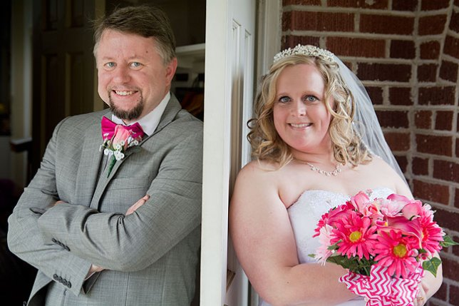I'd never heard of this idea before. Since traditionally the groom shouldn't see the bride before the wedding, Dan and Christa posed together on opposite sides of a door.