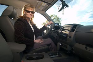 Abby smiles from the driver's seat of her Nissan Frontier, which we absolutely love.