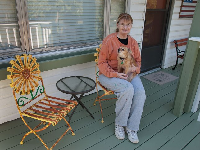 Abby and Sierra sit on the newly-rebuilt front porch and deck. I primed the chairs and painted them yellow, then Abby added the green to the leaves and the orange streaks, which I think was a great artistic touch. I happen to think Abby looks extra cute wearing one of my old long-sleeved painting shirts.