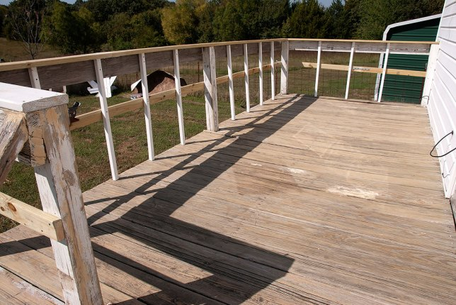 This is the back deck yesterday after I added railing, balusters, and structural reinforcements and sanded the whole thing. I primed it all last night, and hope to paint this evening.