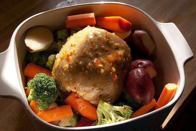 My Tofurky sits in its cooking dish surrounded by carrots, red potatoes, and broccoli, basted with Italian dressing. This is going to be good.