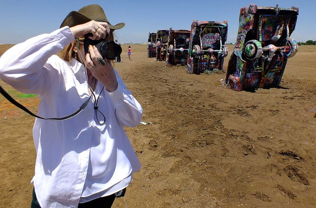 Abby makes pictures at Amarillo's famous Cadillac Ranch on our June vacation.