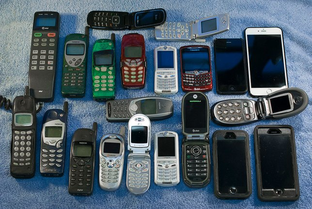 Behold the power of illusion, the illusion that we needed each of these phones that we later threw in the trash. There are 21 phones in this image, though two Motorola Razrs and another an older Nokia ended up in other hands. Three of the phones in this picture belonged to my parents. Also missing is Abby's iPhone 3, which is now the MP3 player in my car. Most of these phones worked fine when they were retired.