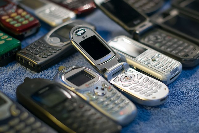 I had fun photographing our collection of derelict cell phones the other night.