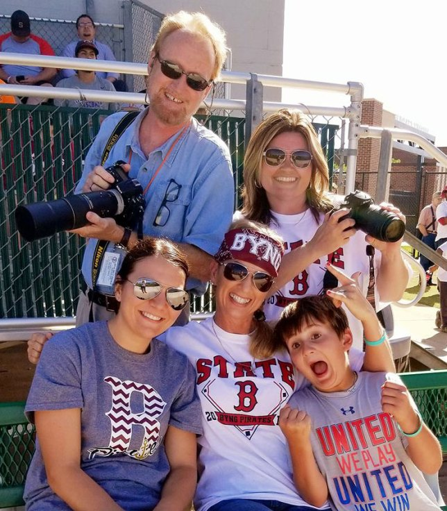 Your humble host poses with some friends at the first round of Class 4A state baseball playoffs in Edmond Thursday evening. I have known Tracey, seated in the center, since she played basketball at Roff in 1990.