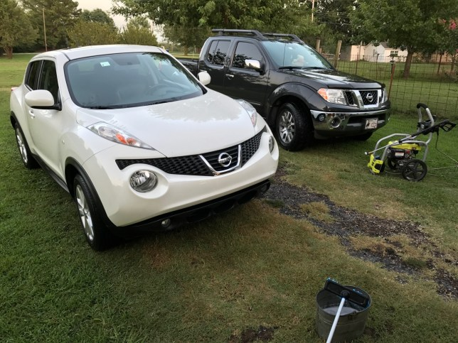 My Nissan Juke and Abby's Nissan Frontier sit in the driveway after I washed and dried them. They look like new.