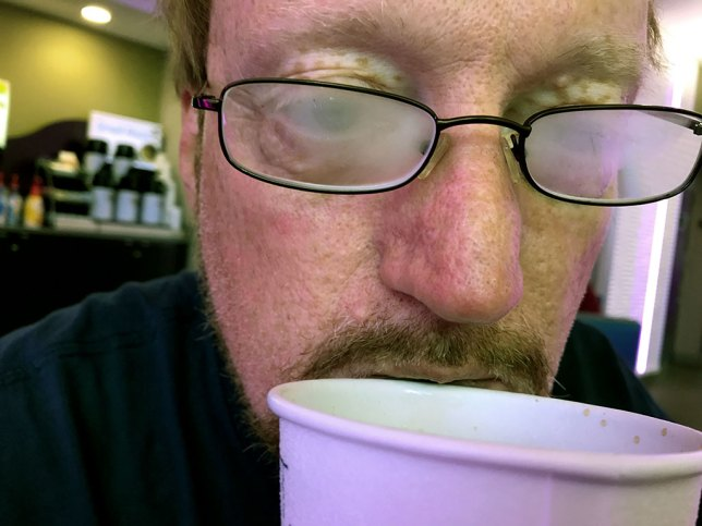 Your host fogs his reading glasses with steam from his morning coffee.