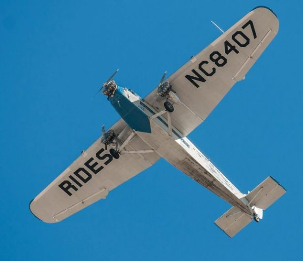 The EAA's historic Ford Tri-Motor lumbers overhead this morning. My media friends and I got to fly in her Thursday.