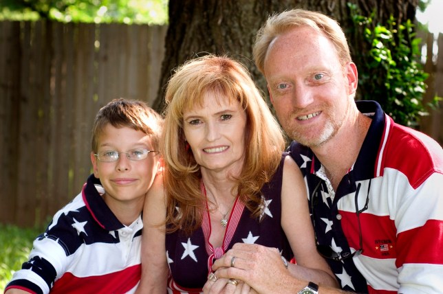 Mitchell and Abby pose with me for the July 4 holiday in 2006. Despite our efforts and Mitchell's potential, he was something of a lost cause.