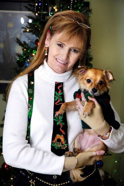 Abby poses with her Chihuahua Sierra at Christmas in 2007. No one I know, even children, love Christmas like she does.
