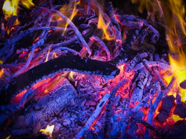 Fire dying to embers is very beautiful to me, especially when the coals take on a bluish tone.