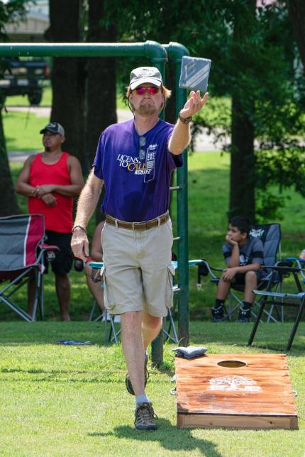 Wes Edens posted this image of me playing in Saturday's cornhole tournament on social media.