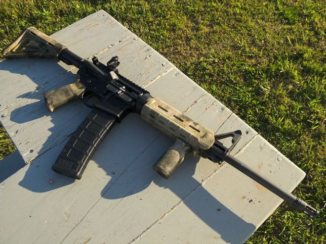 An AR-15 with a 40-round magazine? No. This is an automatic assault rifle machine gun with a huge clip. Thanks, media.