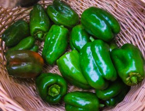 Bell peppers sit in my basket two nights ago. They are good to eat alone, as a salad, or as an ingredient in burritos, soups, beans and more, and they are very nutritious.