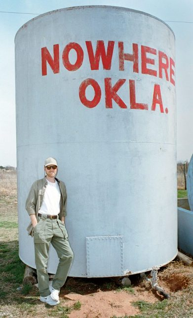 Your humble host of mumbles Richard R. Barron poses at the water tower in Nowhere, Oklahoma in 1999.