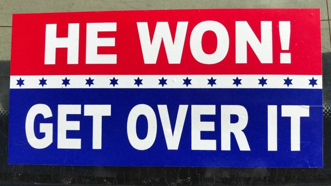 "A couple of things about this bumper sticker I photographed downtown: 1. If she had won, they wouldn't be over it. 2. ""Get over it"" implies we should stop disagreeing, which is not only absurd, but unpatriotic. 3. If he is impeached, when will they ""get over it?"""