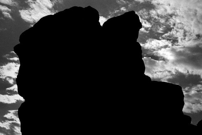 Boulder and clouds near Cerillos, New Mexico.