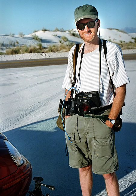 The author poses with hid medium format camera, among others, at White Sands National Monument, New Mexico.