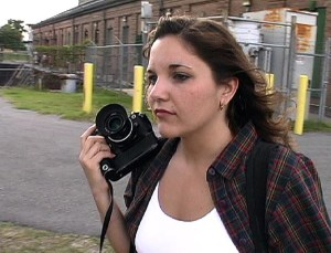 Ann scopes out a photo opportunity at the painted bridge my sister suggested we photograph. This is a screen grab of a video frame.