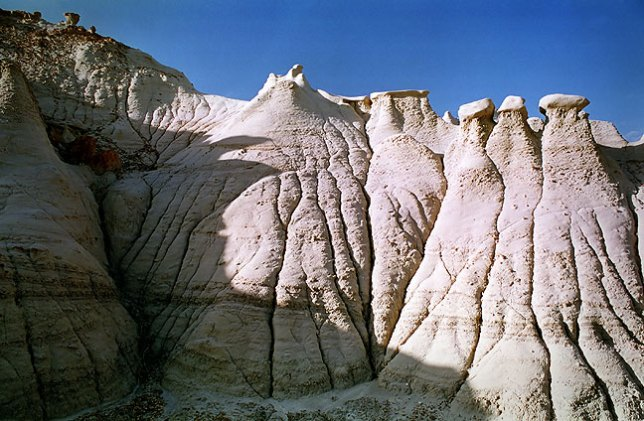 Bleached erosions and embedded hoodoos, morning, Bisti Wilderness.