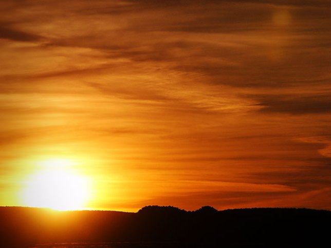 The sun touches the horizon at Caprock Canyons.