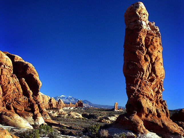 Pinnacles in the Garden of Eden section of Arches are set against a perfectly blue sky.