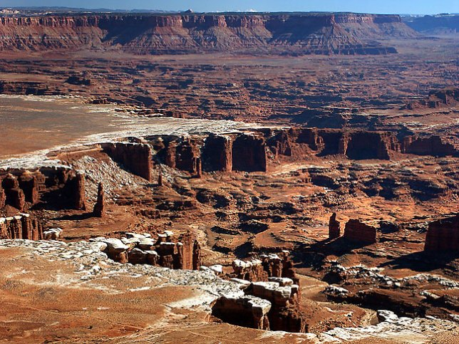 Monument Basin is visible from the White Rim Overlook at Island in the Sky district, with Hatch Point in the distance.
