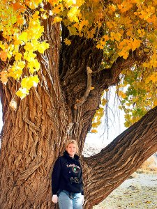 Jamie poses with a beautiful Cottonwood in a riverbed near Four Corners.