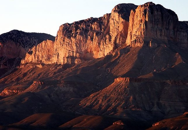 El Capitan Peak on the southern end of the Guadalupe Mountains, stands majestically in evening light.