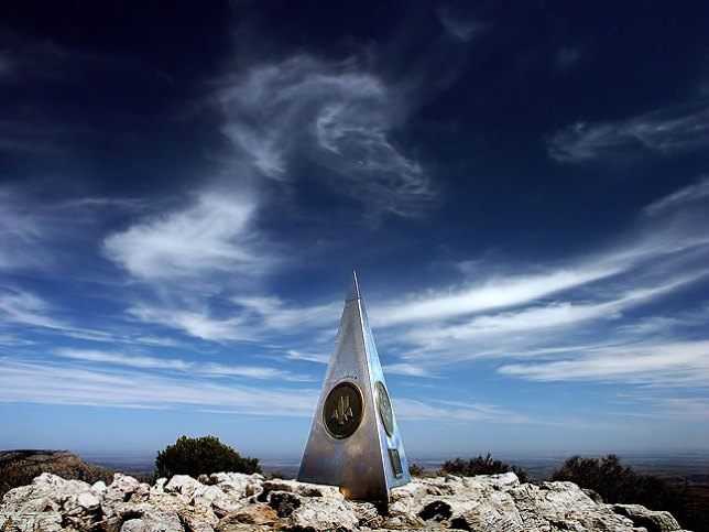 The stainless steel pyramid is set against cirrus clouds on Guadalupe Peak, the high point of Texas.