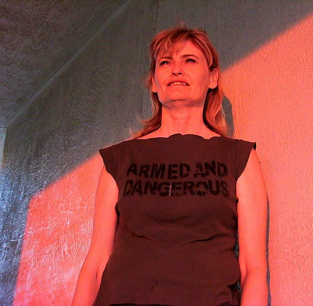 """Abby watches the sun go down in Santa Fe, wearing her """"Armed and Dangerous"""" shirt."""