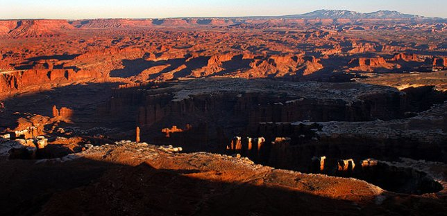 This broader view shows the sunset at Grand View Point at Canyonlands National Park.