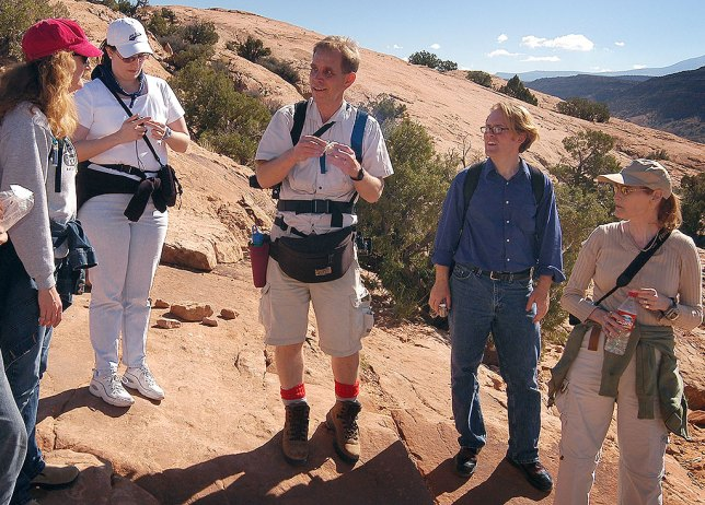 Some of the members of our wedding party gather for a water break on the Delicate Arch trail. From left are Nicole, Chele, David, Robert, and Abby.
