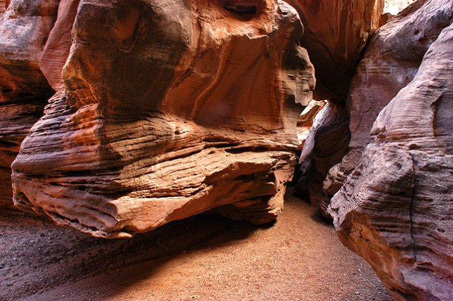The trail passes under the boulder jammed in the crack to the right.