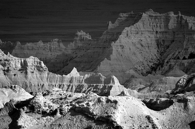 Sunshine and cloud shadows create this dramatic scene at Badlands National Park.