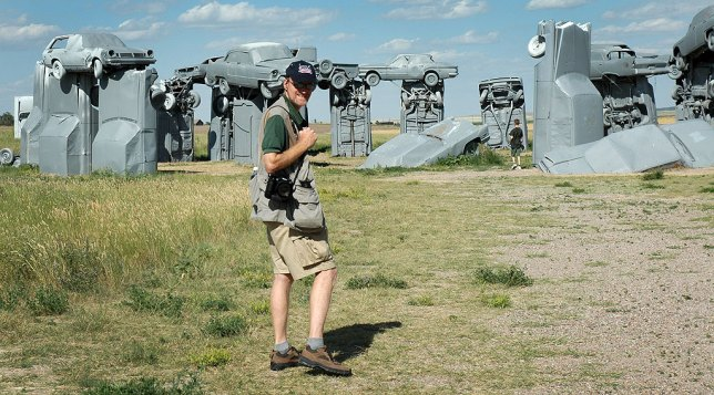 The author approaches the vehicles at Carhenge, a replica of Stonehenge made entirely of cars.