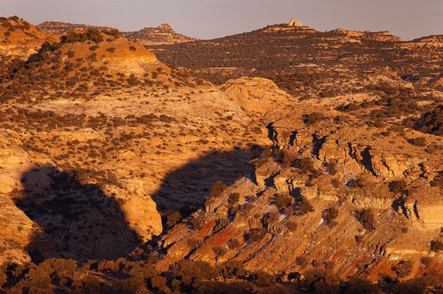 The San Rafael Swell takes on a deep amber tone as sunset approaches.