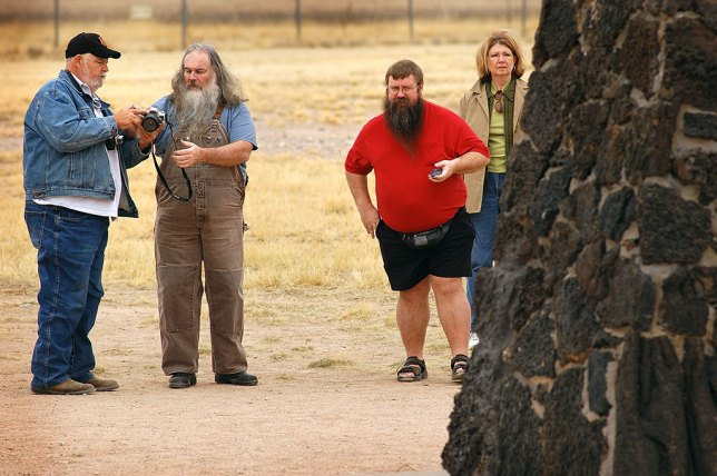 Visitors photograph the marker at the Trinity site.
