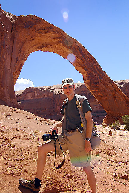 Your host poses at Corona Arch