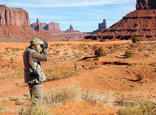 Photographing Monument Valley; it was cold enough that I needed gloves and a fleece pullover, and Abby wore her warmest coat.