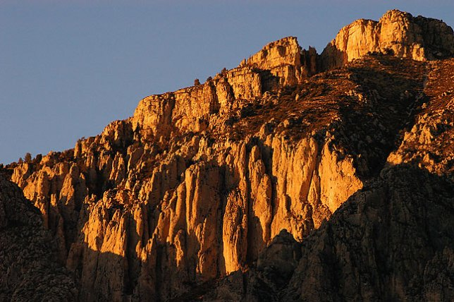 The rugged Hunter Peak shines at last light, Guadalupe Mountains.