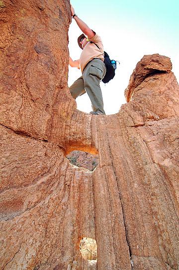 "David climbs on formations near ""balanced rock,"" Big Bend National Park."