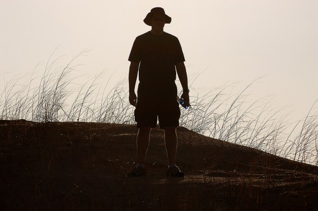 David is silhouetted against the afternoon sky at Monahans Sandhills State Park, Texas.